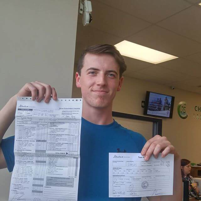Signal Driving's student happy because he passed his driving exam